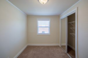 closet with wiring shelves in carpeted bedroom