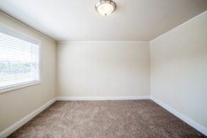 empty, carpeted bedroom with neutral paint